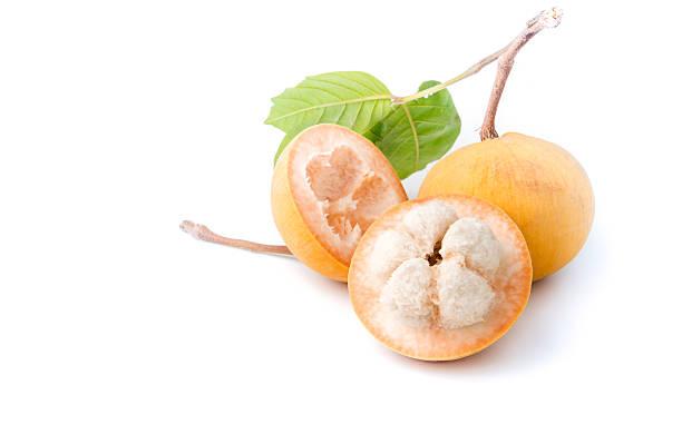 sliced santol fruit isolated on white background